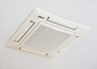 Air conditioner installed on the ceiling of a room
